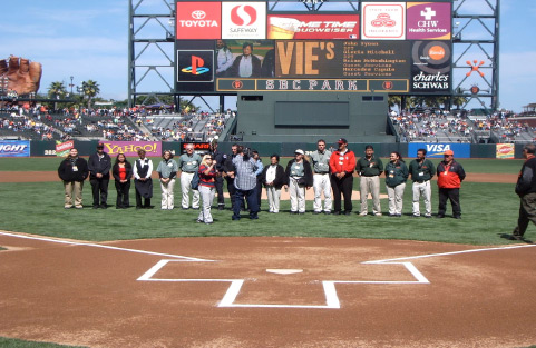 The San Francisco Giants take time out during a game to honor their top employees on the field of AT&T Park.